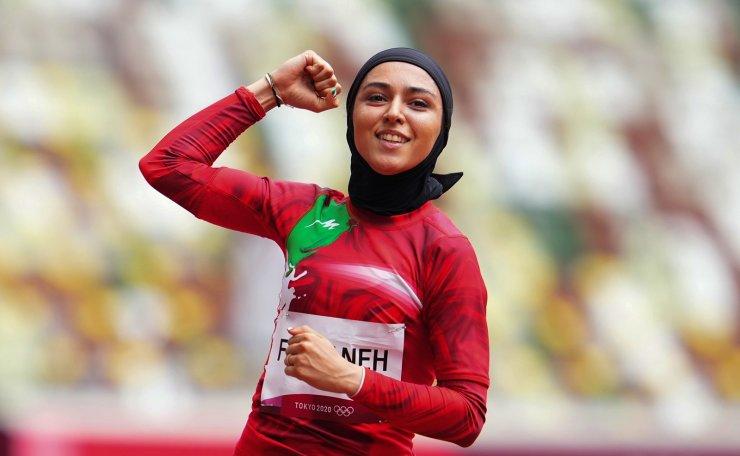 Tokyo 2020 Olympics - Athletics - Women's 100m - Preliminary Round - OLS - Olympic Stadium, Tokyo, Japan - July 30, 2021. Farzaneh Fasihi of Iran reacts celebrates after the race. REUTERS