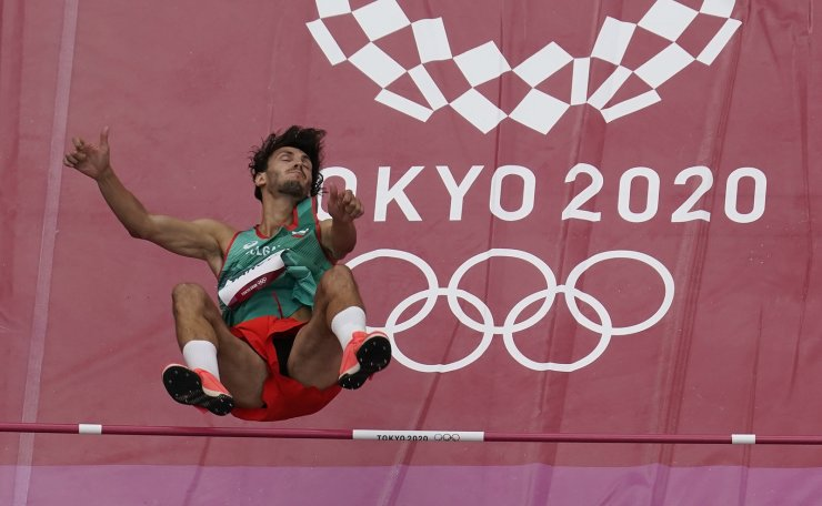 Tihomir Ivanov, of Bulgaria,competes during a preliminary round of the men's high jump at the 2020 Summer Olympics, Friday, July 30, 2021, in Tokyo. AP