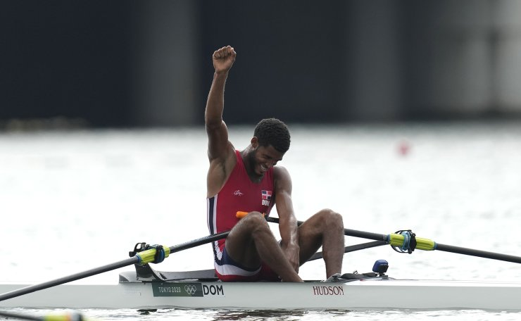 Ignacio Vasquez Jorge, of Dominican Republic reacts after competing in the men's rowing single sculls final at the 2020 Summer Olympics, Friday, July 30, 2021, in Tokyo, Japan. AP