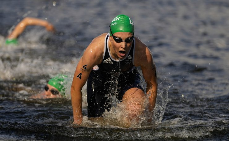 Jessica Learmonth of Britain come out of the water as she competes during the mixed relay triathlon at the 2020 Summer Olympics, Saturday, July 31, 2021, in Tokyo, Japan. AP