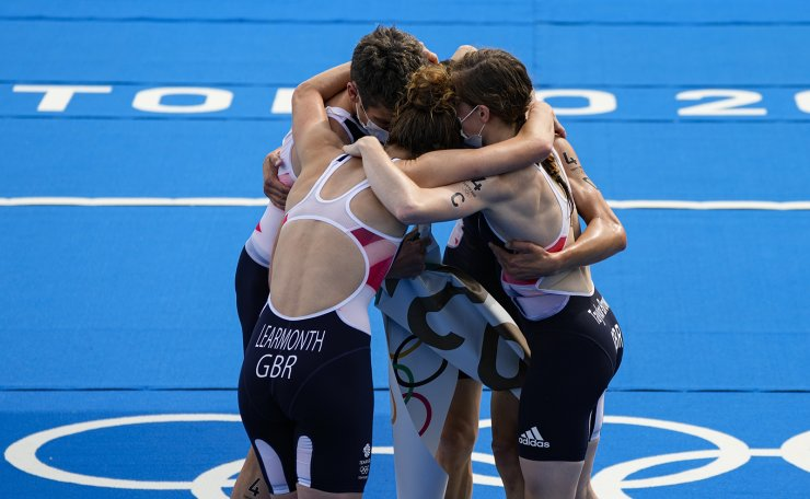 Britain's team celebrates after winning the gold medal in the mixed relay triathlon at the 2020 Summer Olympics, Saturday, July 31, 2021, in Tokyo, Japan. AP