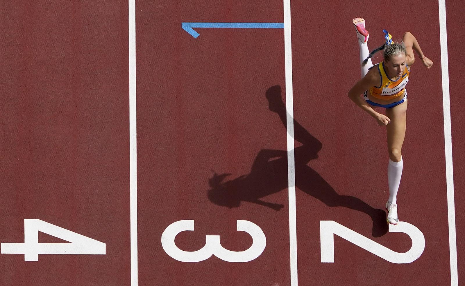 Anna Ryzhykova, of Ukraine, wins her heat in the women's 400-meter hurdles at the 2020 Summer Olympics, Saturday, July 31, 2021, in Tokyo. AP