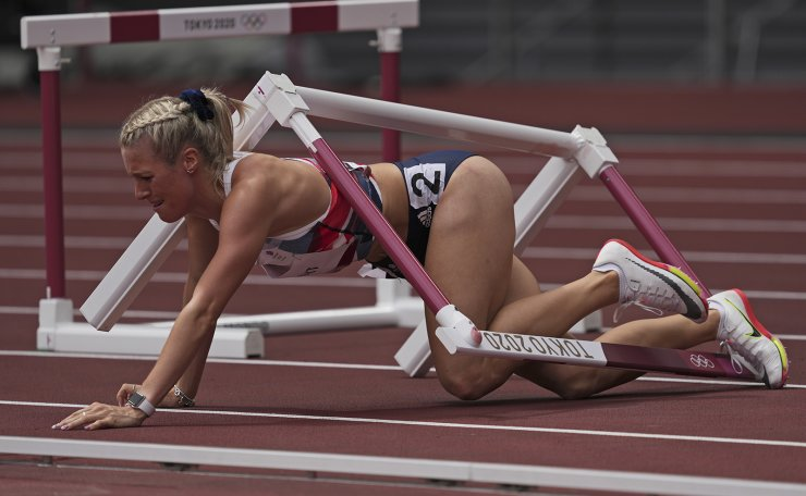 Jessie Knight, of Britain, falls during her heat of the women's 400-meter hurdles at the 2020 Summer Olympics, Saturday, July 31, 2021, in Tokyo. AP