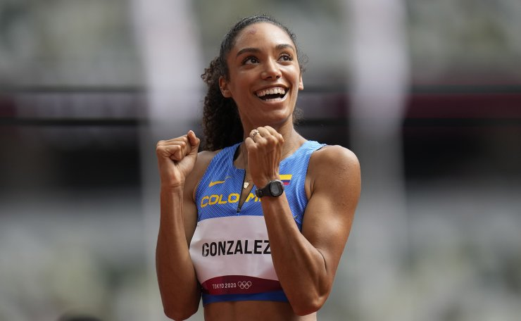 Melissa Gonzalez, of Colombia, reacts after competing in a heat in the women's 400-meter hurdles at the 2020 Summer Olympics, Saturday, July 31, 2021, in Tokyo. AP