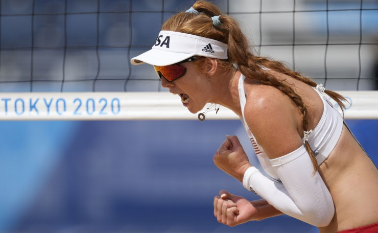 Kelly Claes, of the United States, reacts to a play during a women's beach volleyball match against Brazil at the 2020 Summer Olympics, Saturday, July 31, 2021, in Tokyo, Japan. AP