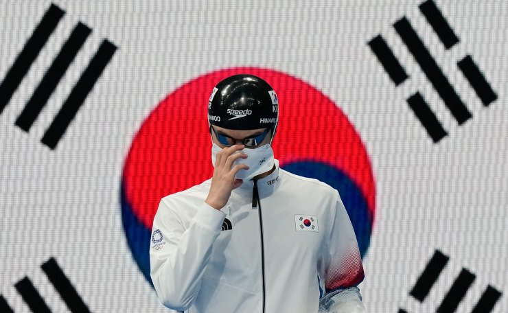 Hwang Sunwoo, of South Korea, arrives for a men's 100-meter freestyle semifinal at the 2020 Summer Olympics, Wednesday, July 28, 2021, in Tokyo, Japan. AP