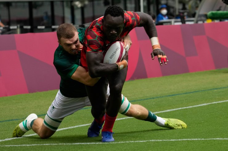 Kenya's Jacob Ojee, front, scores a try as Ireland's Adam Leavy tackles, in their men's rugby sevens 9-10 placing match at the 2020 Summer Olympics, Wednesday, July 28, 2021 in Tokyo, Japan.