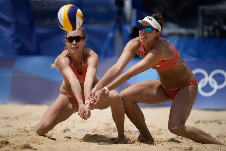 Nina Betschart, left, of Switzerland, and teammate Tanja Huberli converge on the ball during a women's beach volleyball match against Japan at the 2020 Summer Olympics, Wednesday, July 28, 2021, in Tokyo, Japan. AP