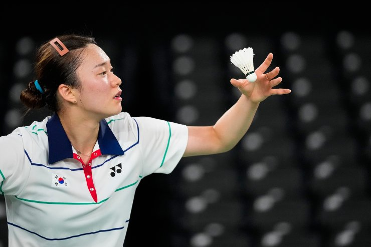 South Korea's Kim Gae-un serves against Singapore's Yeo Jia Min during their women's singles group stage badminton match at the 2020 Summer Olympics, Wednesday, July 28, 2021, in Tokyo, Japan. AP