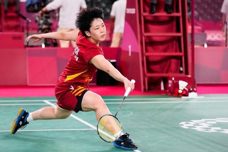 Japan's Akane Yamaguchi plays against Britain's Kristy Gilmour during their women's singles group stage badminton match at the 2020 Summer Olympics, Wednesday, July 28, 2021, in Tokyo, Japan. AP