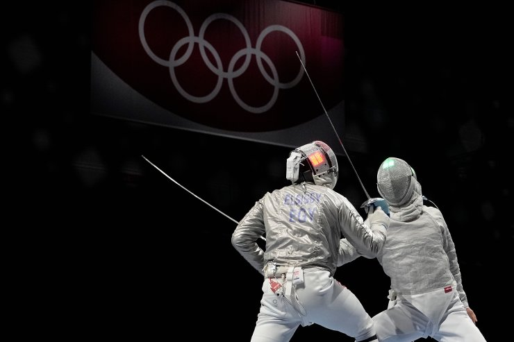 Ziad Elsissy of Egypt, left, and Tomohiro Shimamura of Japan compete in the men's Sabre team final at the 2020 Summer Olympics, Wednesday, July 28, 2021, in Chiba, Japan. AP
