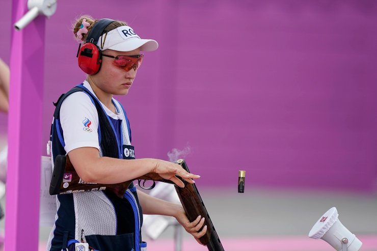 Ekaterina Subbotina, of the Russian Olympic Committee, tosses her shell as she competes in the women's trap at the Asaka Shooting Range in the 2020 Summer Olympics, Wednesday, July 28, 2021, in Tokyo, Japan. AP