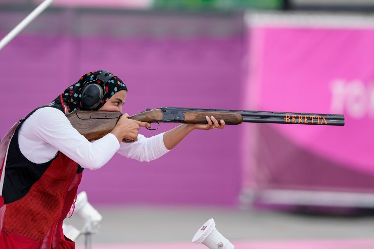 Maggy Ashmawy, of Egypt, competes in the women's trap at the Asaka Shooting Range in the 2020 Summer Olympics, Wednesday, July 28, 2021, in Tokyo, Japan. AP