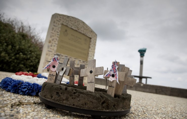 In this photo taken on Thursday, June 4, 2020, faded wooden crosses, some with messages, rests at a monument near Omaha Beach, in Vierville-sur-Mer, Normandy, France. AP