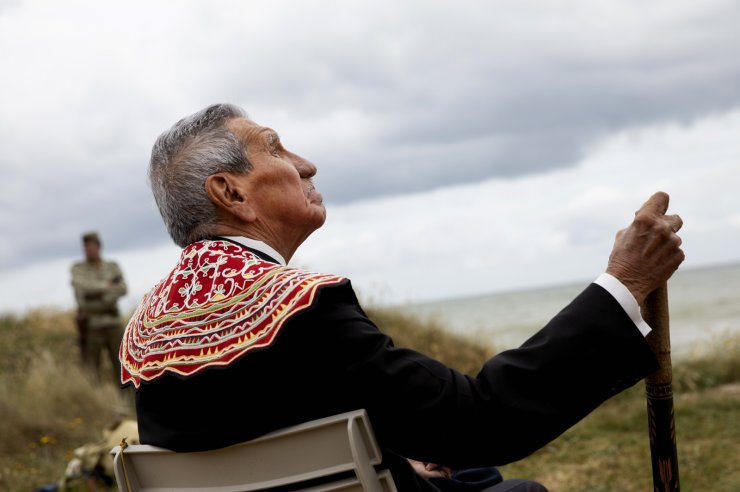 World War II D-Day veteran and Penobscot Elder from Maine, Charles Norman Shay participates in a Native American ceremony at his memorial overlooking Omaha Beach in Saint-Laurent-sur-Mer, Normandy, France, Friday, June 5, 2020. AP