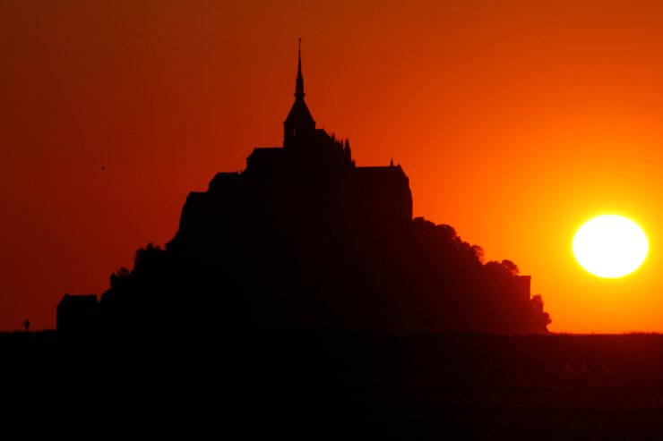 The iconic Mont Saint-Michel is seen at sunset in the French western region of Normandy, as France reopened this monument following the outbreak of the coronavirus disease (COVID-19) in France, June 1, 2020. REUTERS