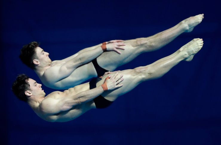 Britain's Thomas Daley and Matthew Lee compete in the men's 10m platform synchro diving final at the World Swimming Championships in Gwangju, South Korea, Monday, July 15, 2019. AP