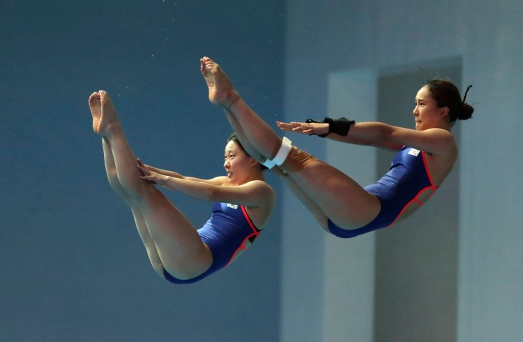 South Korea's Cho Eun-bi and Moon Na-yun during the women's 10m synchro platform competitions at the World Swimming Championships in Gwangju, South Korea, Sunday, July 14, 2019. AP