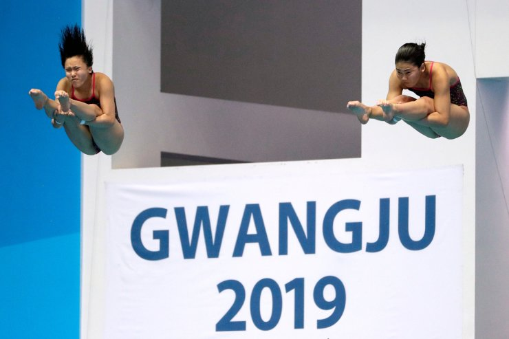 Haruka Enomoto and Hazuki Miyamoto of Japan compete in the preliminary of the women's 3 meter synchronized springboard diving competition at the World Swimming Championships in Gwangju, South Korea, Monday, July 15, 2019. AP
