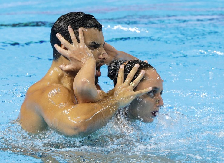 Brazil's Renan Souza and Giovana Stephan perform during the artistic swimming mixed duet technical preliminaries at the World Swimming Championships in Gwangju, South Korea, Saturday, July 13, 2019. AP