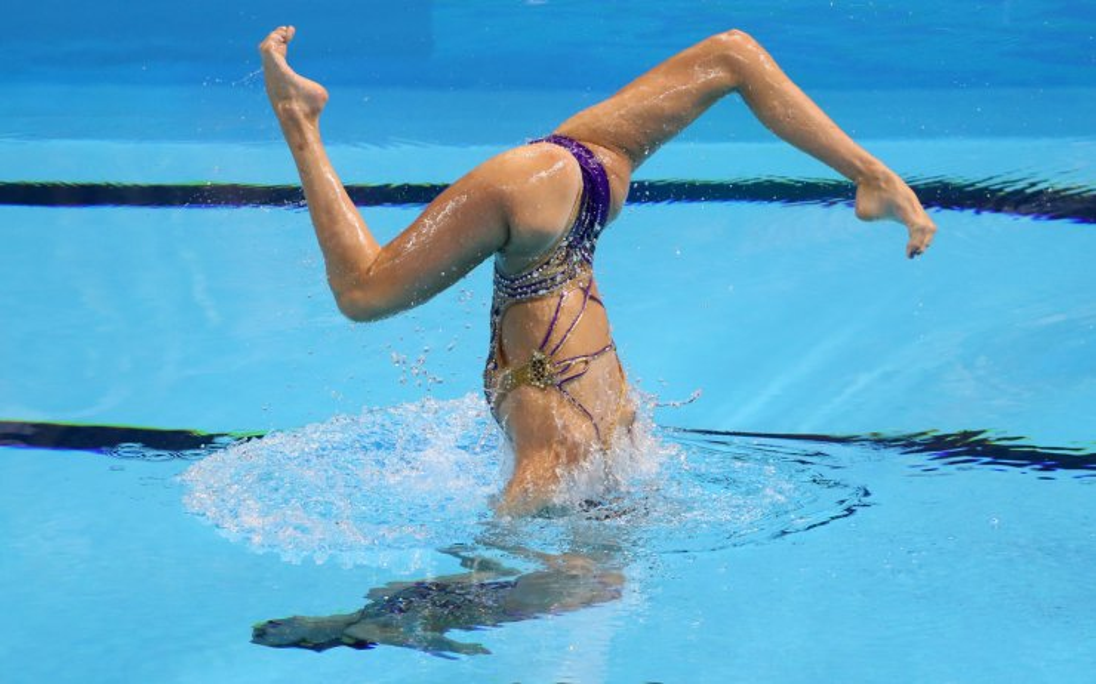 <span>Austria's Anna-Maria Alexandri and Eirini Alexandri perform their routine women's duet technical final at the World Swimming Championships in Gwangju, South Korea, Tuesday, July 16, 2019. Reuters</span><br /><br />