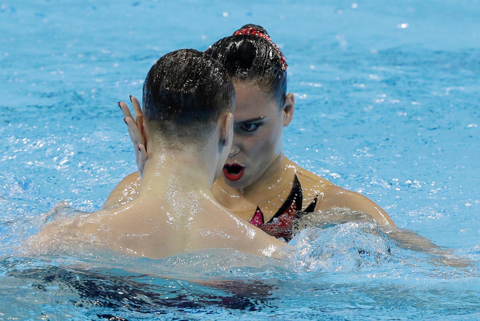Russia's Mayya Gurbanberdieva and Aleksandr Maltsev perform during the artistic swimming mixed duet technical preliminaries at the World Swimming Championships in Gwangju, South Korea, Saturday, July 13, 2019. AP