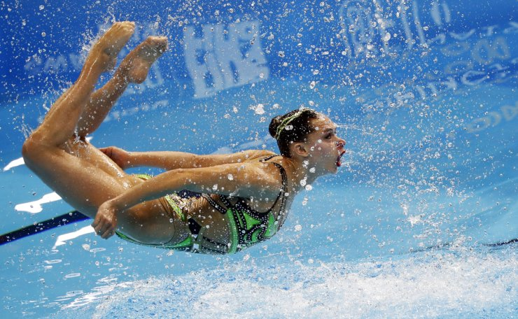 France's Charlotte Tremble and France's Laura Tremble compete in the women's duet free artistic swimming event during the 2019 World Championships at Yeomju Gymnasium in Gwangju on July 16, 2019. Reuters