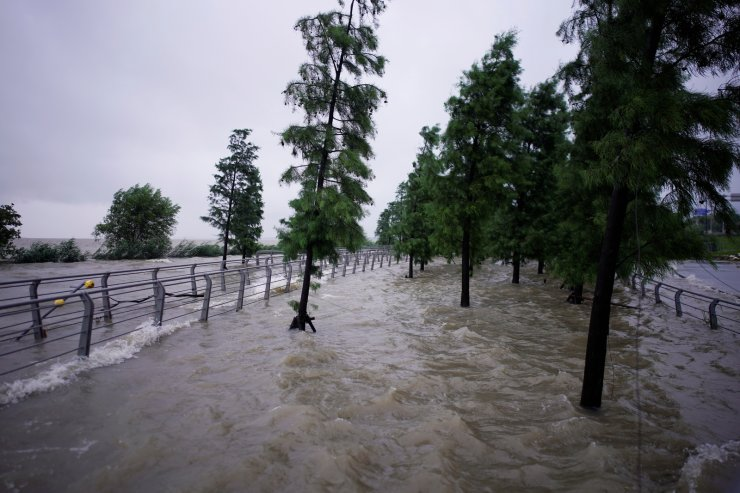 A view of floodwaters overflown to the banks of Tai Lake following heavy rainfall in Huzhou, Zhejiang province, China July 15, 2020. REUTERS