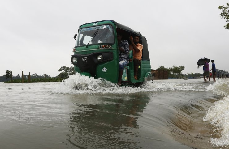 Photo taken on July 12, 2020 shows a flooded road in Sunamganj, Bangladesh. The floods in parts of Bangladesh have affected over 1.3 million people and displaced tens of thousands of families, official data revealed Sunday. Xinhua