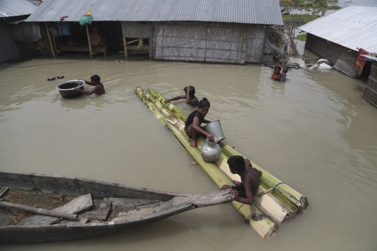 Flood affected villagers are seen near their partially submerged houses in Gagolmari village, Morigaon district, Assam, India, Tuesday, July 14, 2020. Hundreds of thousands of people have been affected by floodwaters and landslides following incessant rainfall in the region. AP