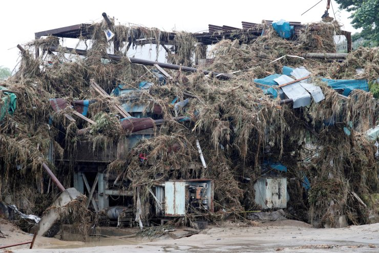 A damaged building is covered in debris, at a stone quarry, after floods caused by torrential rain swept through Kumamura, Kumamoto Prefecture, southwestern Japan, July 9, 2020. REUTERS
