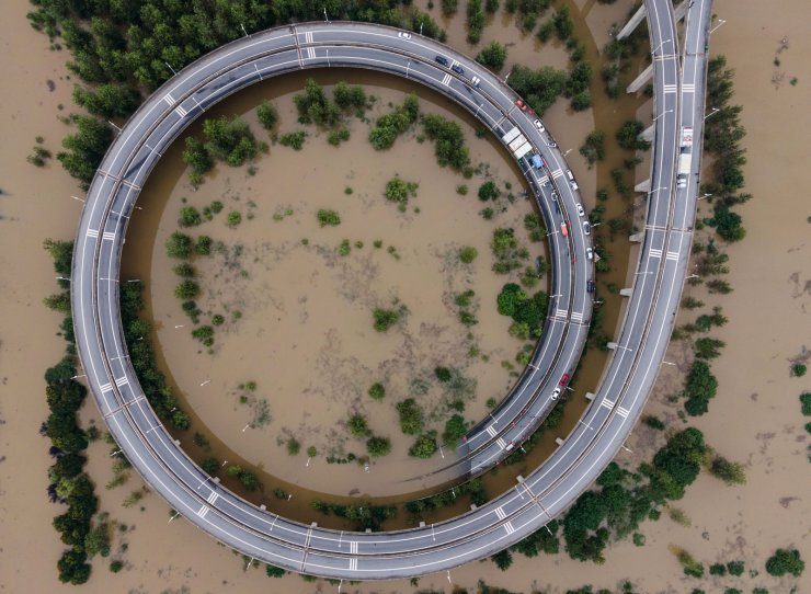 This aerial view shows a bridge leading to the inundated Tianxingzhou island, which is set to be a flood flowing zone to relieve pressure from the high level of water in Yangtze River, in Wuhan in China's central Hubei province on July 13, 2020. - Various parts of China have been hit by continuous downpours since June, with the damage adding pressure to a domestic economy already hit by the coronavirus pandemic. AFP