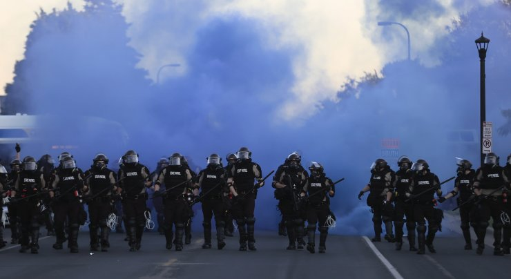 A line of Minnesota State Troopers as protesters demonstrate during the fifth day of protests over the arrest of George Floyd, who later died in police custody, in Minneapolis, Minnesota, USA, 30 May 2020. A bystander's video posted online on 25 May, appeared to show George Floyd, 46, pleading with arresting officers that he couldn't breathe as an officer knelt on his neck. The unarmed black man later died in police custody. EPA