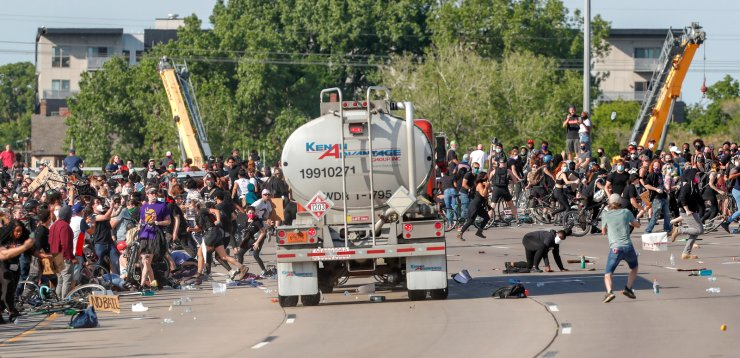 A tanker truck drives into thousands of protesters marching on 35W north bound highway during a protest against the death in Minneapolis police custody of George Floyd, in Minneapolis, Minnesota, U.S. May 31, 2020. REUTERS