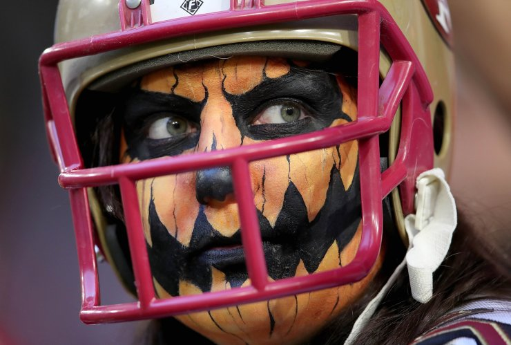 Arizona Cardinals fan in Halloween make-up looks before the game against the San Francisco 49ers in the game at State Farm Stadium on October 31, 2019 in Glendale, Arizona. AFP