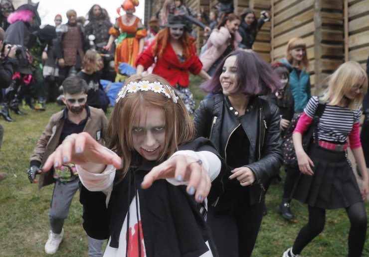 Ukrainians wearing zombie costumes and make-up take part in the Zombie Walk Kiev/Halloween 2019 Halloween parade in Kiev, Ukraine, 26 October 2019. Hundreds Ukrainians marched in Kiev to mark Halloween, which is celebrated on 31 October every year. EPA