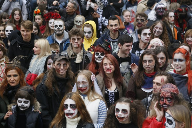 People dressed as Zombies participate in a 'Zombie Walk' on the weekend before Halloween in central Kyiv, Ukraine Saturday, Oct. 26, 2019. AP