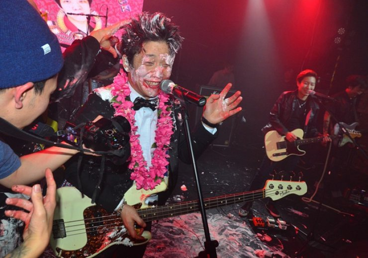 Crying Nut bassist Han Kyung-rok, or Captain Rock, celebrates his birthday with a cake-slathered performance in Yes24 Muv Hall in Hongdae, on Feb. 11 this year. / Courtesy of Jon Dunbar