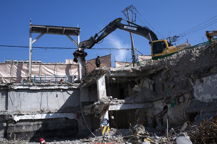 An excavator demolishes a building as part of the Cheongnyangni 588redevelopment project.