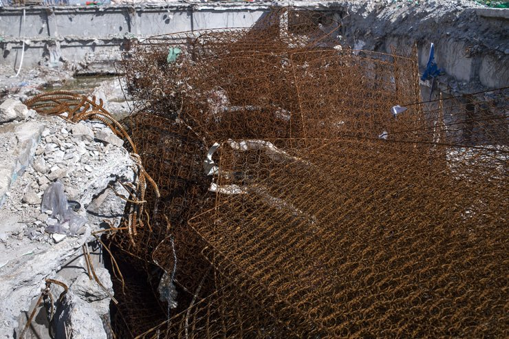 Mattress springs are piled in a hole at a demolition site in Cheongnyangni 588.