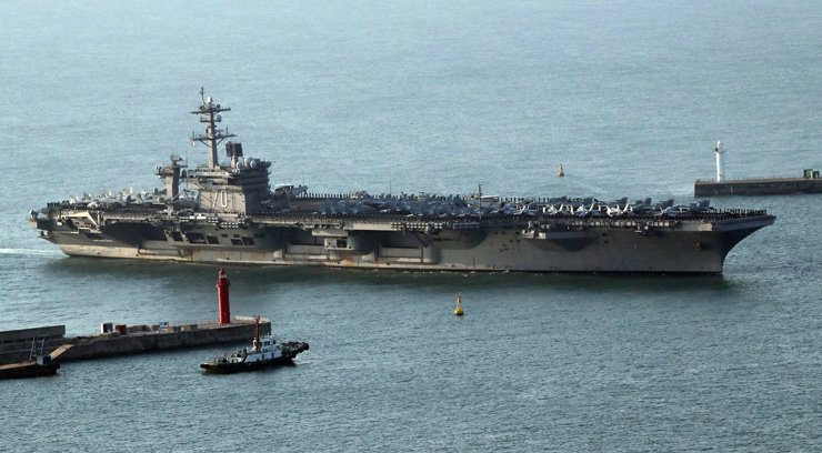 The USS Carl Vinson supercarrier arrives at a port in Busan, 15 March. The Carl Vinson U.S. Navy Strike Group, which includes the USS Carl Vinson (CVN 70), is moving toward the Korean peninsula to provide a 'show of force' against North Korea in the wake of North Korean ballistic missile tests and reported increased activity at North Korea's nuclear test site. / EPA-Yonhap