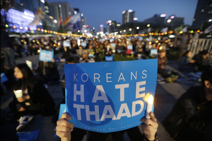 Protesters rally near the U.S. Embassy in Seoul on April 29 to protest against the Terminal High-Altitude Area Defense system (THAAD), a day after Donald Trump suggested billing South Korea for it. / AP-Yonhap