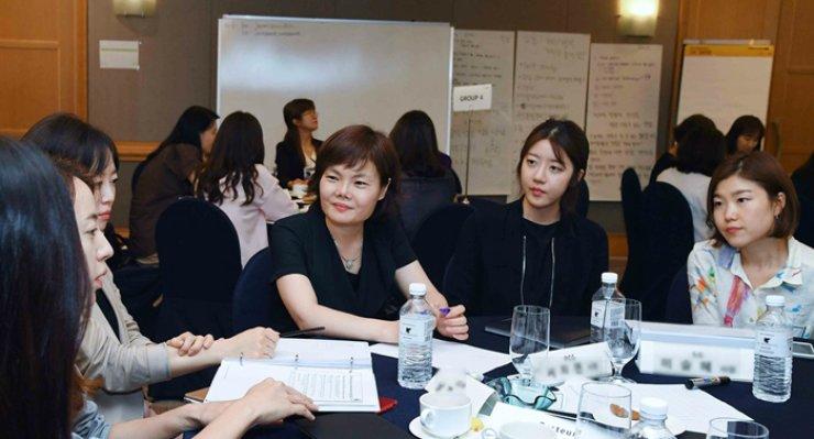 Employees of Sanofi participate in the company's career coaching program -- the Mini-Catalyst -- in Seoul, July 4. / Courtesy of Sanofi