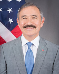 A clean-shaven Harry Harris is pictured in military uniform when he was the head of the U.S. Pacific Command before being appointed U.S. ambassador to Korea. / Courtesy of U.S. Embassy Harry Harris is pictured plus moustache after he took up his post as U.S. ambassador to Korea in July 2018. / Courtesy of U.S. Embassy