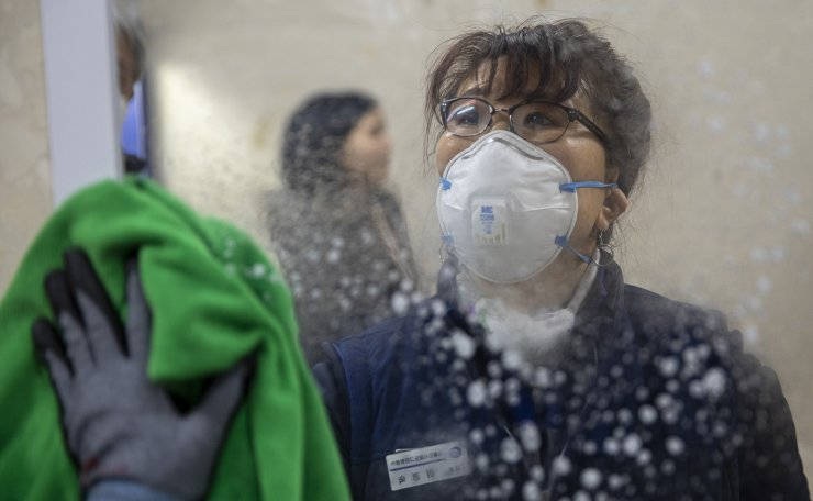 An employee disinfects the platform to prevent transmission of the coronavirus at a subway station in Seoul, South Korea, Tuesday, Jan. 28, 2020. Korea Times photo by Shim Hyun-chul