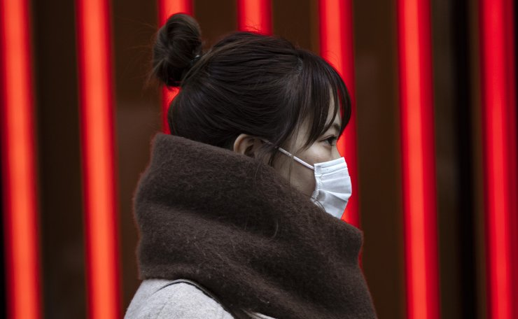A woman wears a mask in the main streets in Myeongdong. Myeongdong is hit by a decreasing number of tourists from China. Korea Times photo by Shim Hyun-chul