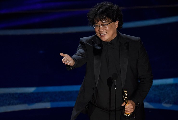 Bong Joon Ho accepts the award for best director for 'Parasite' at the Oscars on Sunday, Feb. 9, 2020, at the Dolby Theatre in Los Angeles. (AP Photo/Chris Pizzello)