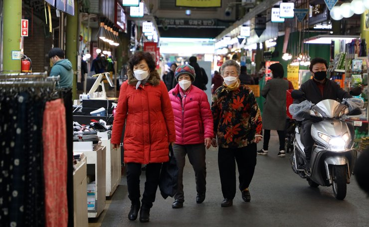 People wearing mask are seen at a market in Seoul,  South Korea, Tuesday, Feb. 24, 2020.  Korea Times photo by Choi Won-suk