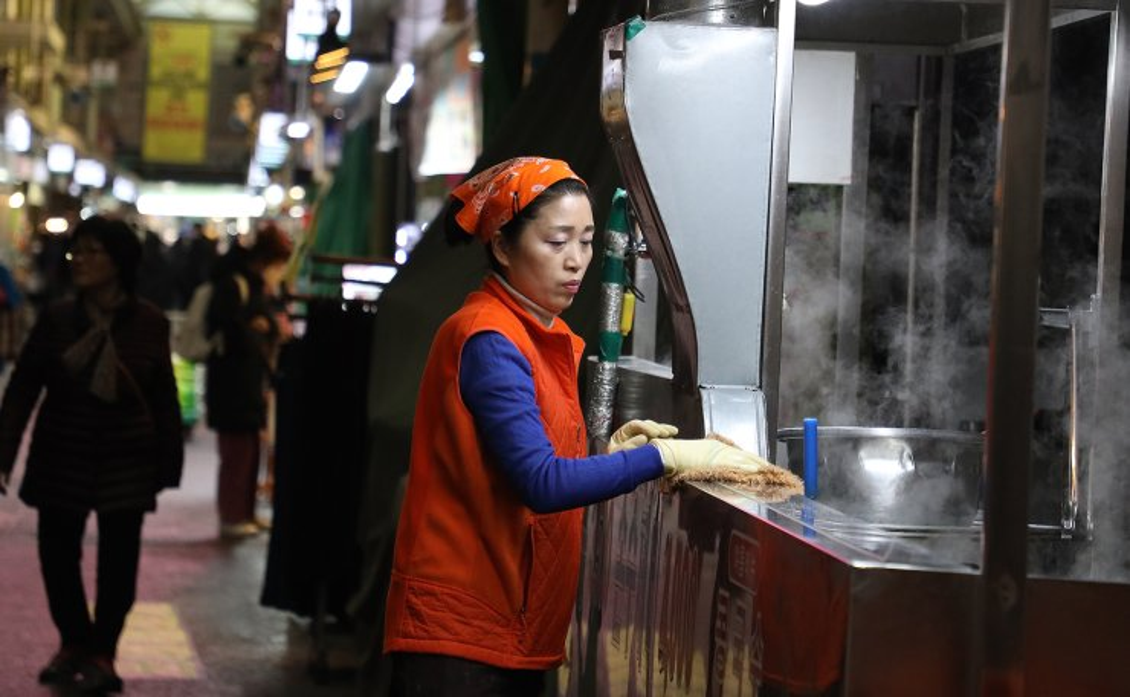 A food vendor waits for the customers at a market at a market in Seoul, South Korea, Monday, Feb. 24, 2020. Korea Times photo by Choi Won-suk