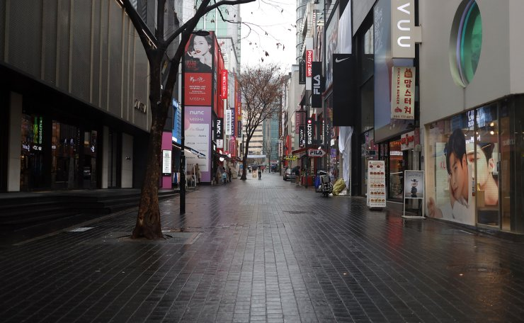 A street in Myeongdong, a famous tourist destination in Seoul, is empty, Tuesday afternoon, March 10, 2020. COVID-19 has hit businesses in Myeongdong, some of which closed indefinitely because of a sharp decline of visitors, hard. Korea Times photo by Choi Won-suk